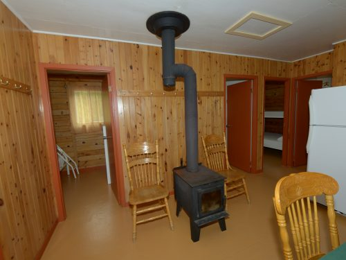 Essipit - Foyer d'un chalet du Domaine du Lac des Cœurs